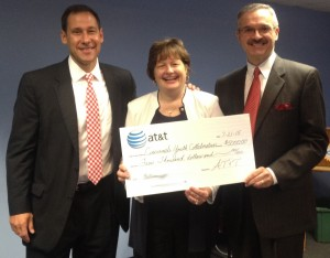 CYC Board Chair Kent Wellington, CYC President and CEO Jane Keller, and AT&T Director of External Affairs Mark A Romito